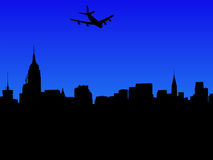 Plane arriving in Manhattan. Four engine plane arriving in Midtown Manhattan skyline Stock Images