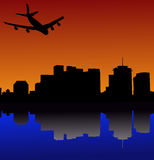 Plane arriving in New Orleans. Four engine plane arriving in New Orleans at sunset Stock Photos
