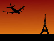 Plane arriving in Paris. Four engine plane flying towards Eiffel tower in Paris Royalty Free Stock Photo