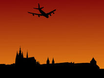 Plane arriving in Prague. With St Vitus cathedral and castle Stock Photo