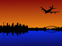 Plane arriving in Sydney. Four engine plane flying towards Sydney with harbour bridge at sunset Royalty Free Stock Photography