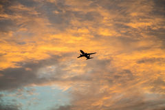 Plane Ascending at Dawn Royalty Free Stock Photos