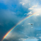 Plane ascending toward rainbow. After a storm clears in Charlotte NC Stock Photos