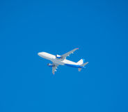 Plane on a background of blue without a cloud in the sky Royalty Free Stock Photos