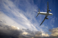 Plane and bad weather. Plane is escaping from bad weather royalty free stock photos