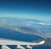 Plane in beautyful Italy sky. Vesuvius legends.  Stock Photo