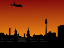 Plane and Berlin skyline Royalty Free Stock Photography