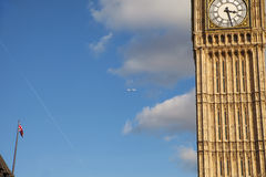 Plane and Big Ben. Royalty Free Stock Image