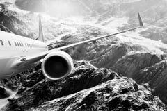 Plane black white travel transportion airplane mountains. Plane black white travel transportion airplane Royalty Free Stock Photo