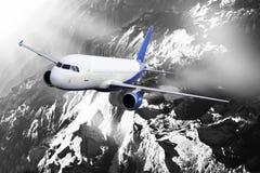 Plane blue black white cloud travel transportion airplane mountains. Plane black white travel transportion airplane Stock Photography