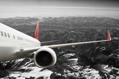 Plane red black white travel transportion airplane mountains. Plane black white travel transportion airplane Royalty Free Stock Photos