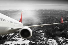 Plane red black white travel transportion airplane mountains. Plane black white travel transportion airplane Stock Photography