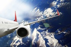 Plane red cloud travel transportion airplane mountains. Plane black white travel transportion airplane Royalty Free Stock Photo