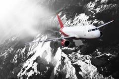 Plane red black white cloud travel transportion airplane mountains. Plane black white travel transportion airplane Royalty Free Stock Image