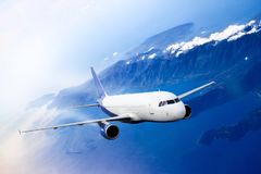 Plane blue cloud travel transportion airplane mountains. Plane blue cloud travel transportion airplane Royalty Free Stock Photo