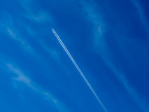Plane in Blue Sky Stock Images
