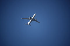 Plane in the blue sky Royalty Free Stock Photography