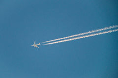 Plane in blue sky Royalty Free Stock Image