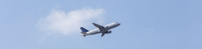 Plane in the blue sky panorama Royalty Free Stock Images