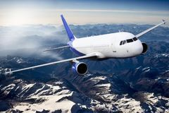 Plane blue travel transportion airplane mountains. Plane black white travel transportion airplane Royalty Free Stock Image
