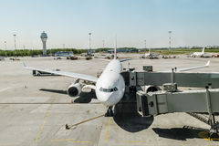Plane with boarding ramp at the airport Pulkovo.Russia. Stock Photos