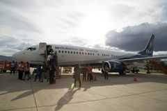 The plane of Bolivian Airlines with passengers, Bolivia Stock Photos