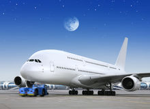 Plane in the bright of the moon Stock Photo