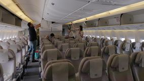 Plane cabin interior during boarding