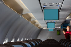 Plane cabin with screens Royalty Free Stock Photos