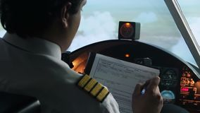 Plane captain writing down information in flight plan, autopilot, transportation. Stock footage stock video footage