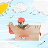 Plane of cardboard. Child flies with his plane of cardboard Royalty Free Stock Photography