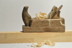 Hand plane. Carpenter plane leveled beam next to the chips fall Royalty Free Stock Image