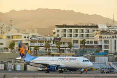 Plane in city airport Eilat Israel. Plane of israeli airline, landed at the airport of Eilat at dusk, 2016, Israel. The Eilat airport is used for internal Royalty Free Stock Image