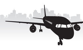 Plane with city background. Plane with grey city background Stock Photo