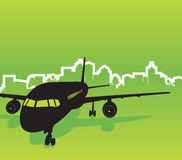 Plane with city background. Plane with green city background Stock Photo