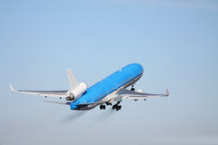 Plane in a clear blue sky Stock Photography