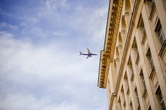 Plane on clear blue sky Stock Photography