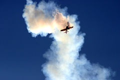 Plane in the cloud of smoke royalty free stock image