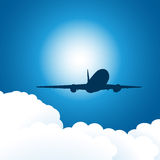 Plane and clouds Stock Image