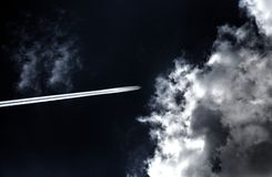 Plane in the clouds Royalty Free Stock Photography