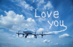 Plane with clouds font Royalty Free Stock Image
