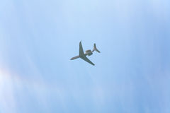 Plane in the cloudy sky Royalty Free Stock Photo