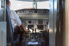 Plane cockpit with pilots after landing Royalty Free Stock Image