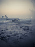 Plane on a cold morning. Color shot of a commercial airplane on the runaway, on a cold winter morning Stock Image
