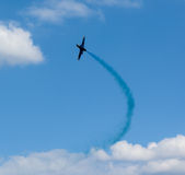 Plane with colorful trail in the sky Royalty Free Stock Photography