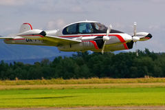 Plane coming in to land. Propeller driven plane from Czech Republic with wheels down coming in to land on a grassy airfield Stock Photo