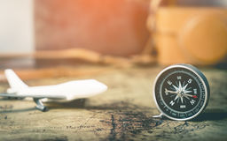 Plane compass on vintage map Stock Photo