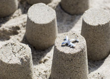 Plane on a cone figure made of beach sand. Royalty Free Stock Images