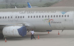 Plane covered by volcanic ash from mount kelud eruption. INDONESIA, SOLO : Volcanic ash covers planes and the airport of Solo in Central Java about 150 stock images