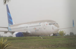 Plane covered by volcanic ash from mount kelud eruption. INDONESIA, SOLO : Volcanic ash covers planes and the airport of Solo in Central Java about 150 royalty free stock images